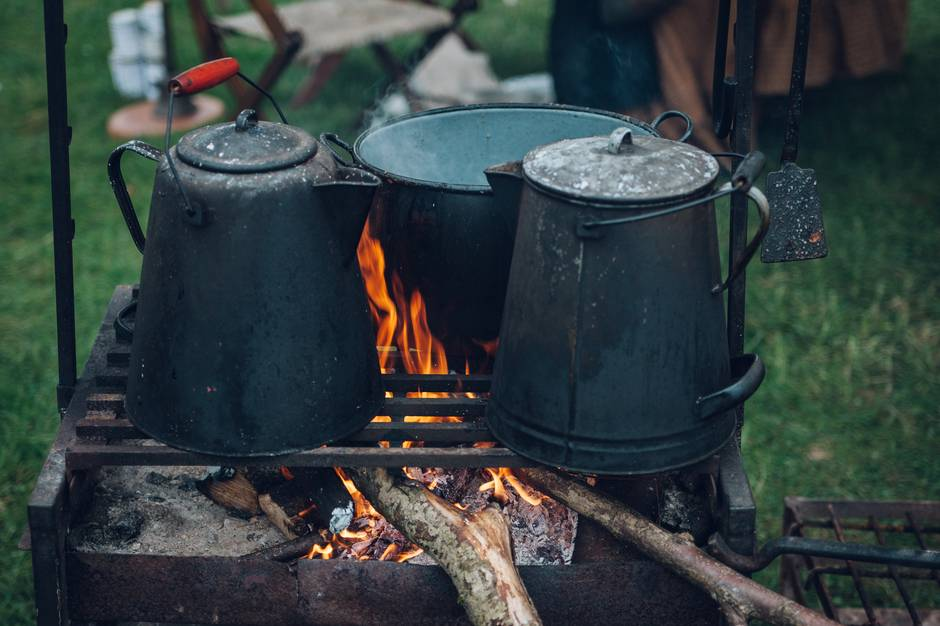A pot that is sitting on a grill